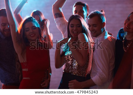 Dancing in night club