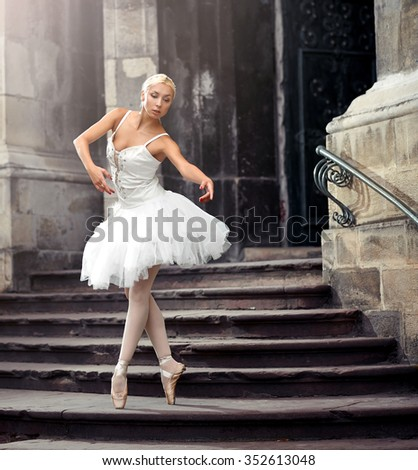 Dancing is her love. Soft focus shot of a beautiful ballerina practicing her ballet moves  - stock photo