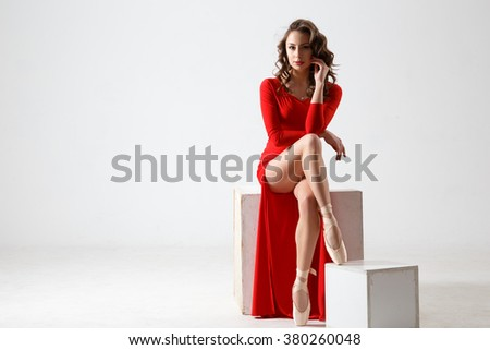 Dancing lady in a red dress. Contemporary modern dance on a white background isolated. Fitness, stretching model - stock photo