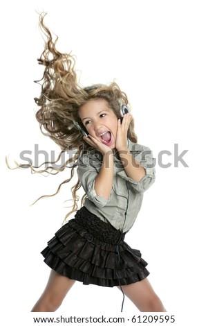 dancing little blond girl headphones music singing on white background - stock photo