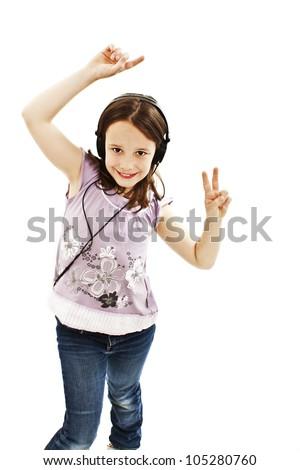 Dancing little girl headphones music on white background - stock photo