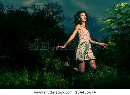 Dancing outdoors in spring time. Springtime fun. Colorized image - stock photo