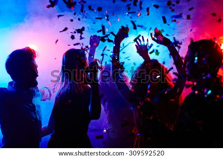 Dancing people at nightclub on Halloween night - stock photo