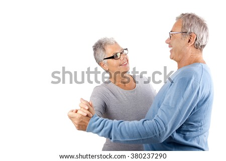 dancing Senior couple, mature couple, age and people concept - happy senior couple