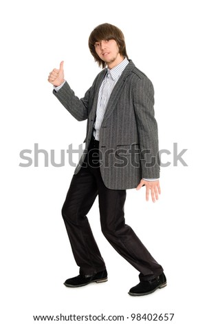 Dancing stylish young man in a gray jacket