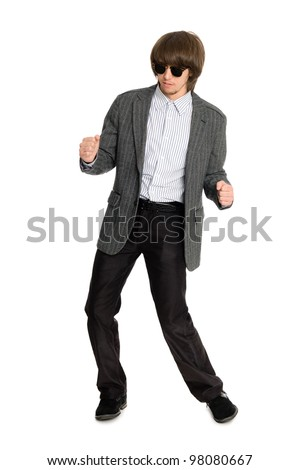 Dancing stylish young man on a white background