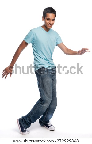 Dancing teenager on a white studio background. - stock photo