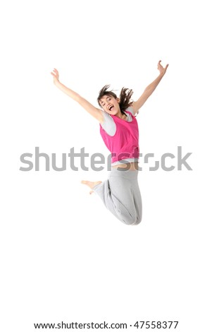 Dancing woman in pink and happy smiling facial expression jumping up.