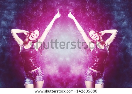 dancing woman in purple and blue colors studio shot - stock photo