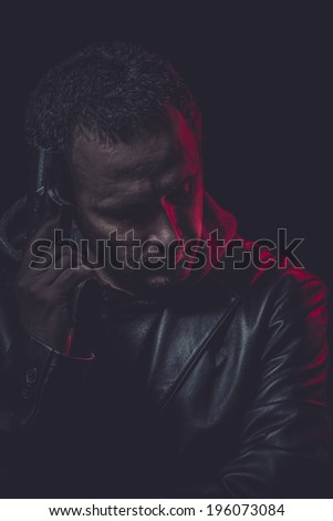 Danger, Assassin, man with black coat and gun - stock photo
