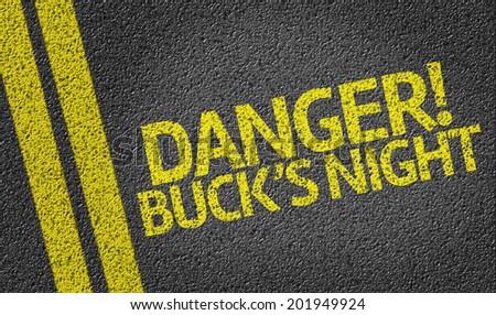Danger! Buck's Night written on the road - stock photo