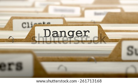 Danger Concept. Word on Folder Register of Card Index. Selective Focus.