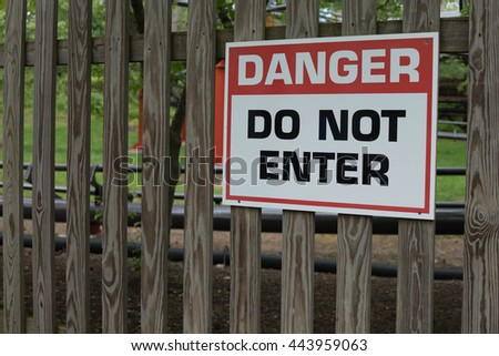 Danger Do Not Enter Sign on Wooden Fence