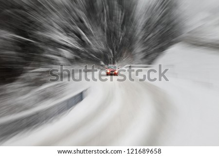 Danger driving at the heavy snow road. Motion zoom visualizies the speed and dynamics. - stock photo