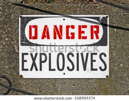 danger explosives, warning message on signboard, stress environment - stock photo
