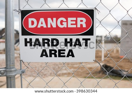 Danger Hard Hat Area Sign on Chain Link Fence - stock photo