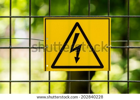 Danger High Voltage Electric Fence Warning Sign - stock photo