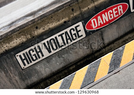 Danger high voltage warning sign with black and yellow hazard stripes. - stock photo