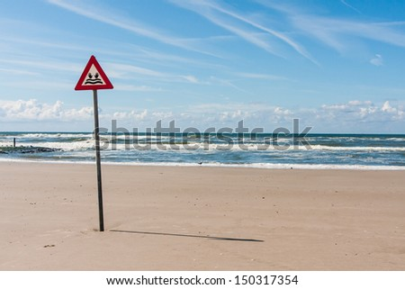 danger label drowning at the North Sea - stock photo