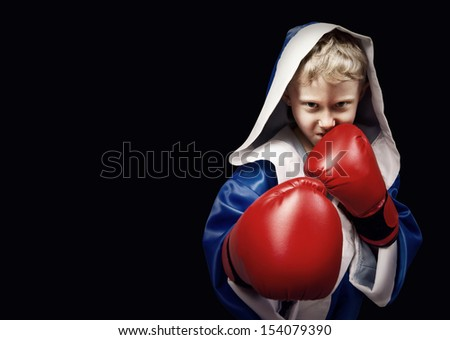 Danger looking little boxing fighter on the black background - stock photo