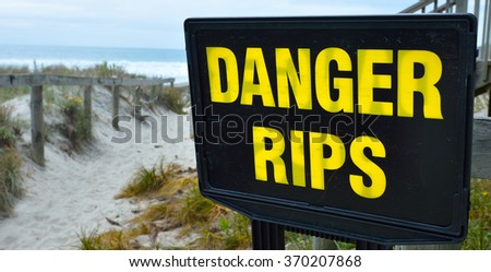 Danger rips of strong currents sign posted on the beach. copy space concept conceptual. - stock photo