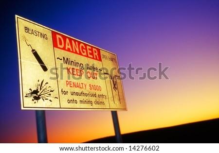 Danger roadsign in opal mine, Coober Pedy, Australia - stock photo