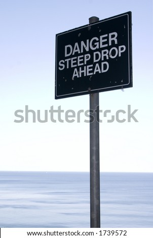 Danger sign at edge of the cliff