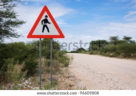 Danger sign: people crossing road, Namibia - stock photo