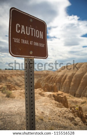 Danger sign with limited access to a footpath at the Cathedral Gorge State Park in Eastern Nevada - stock photo