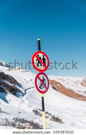 Danger sings on winter skiing resort - stock photo