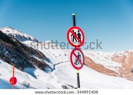 Danger sings on winter skiing resort - stock photo