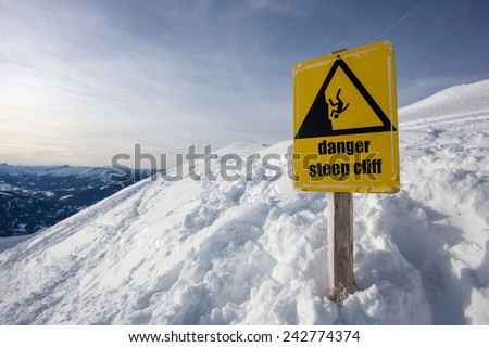 danger steep cliff mountain sign - stock photo