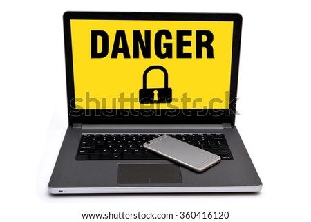 Danger vulnerable Sign lock with laptop and smart phone - stock photo