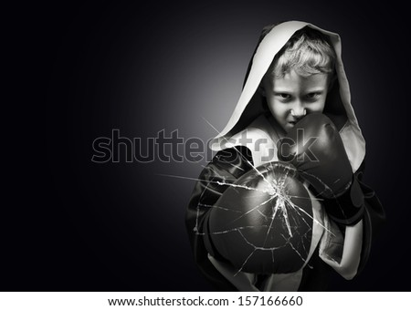 Danger young boxer fighter kick camera lens black and white image - stock photo