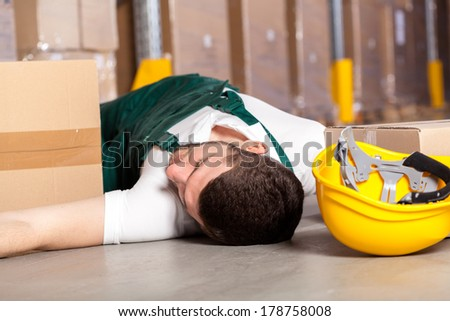 Dangerous accident at work in factory warehouse - stock photo