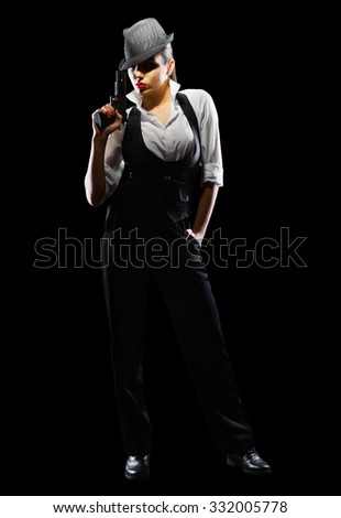 Dangerous and beautiful criminal girl with gun isolated - stock photo