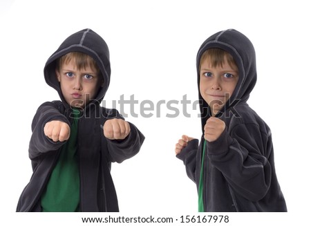 dangerous brothers threaten with the fists - stock photo
