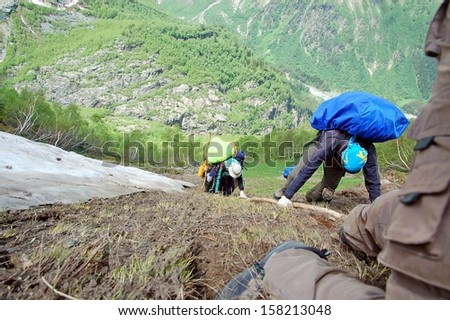 Dangerous climb a steep hill - stock photo