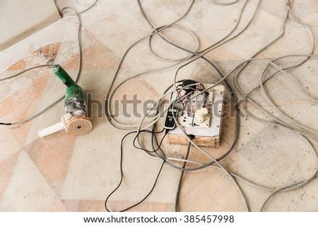 Dangerous electrical extension with bare wires. - stock photo