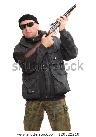 Dangerous gangster or terrorist with shotgun. - stock photo