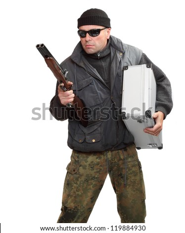 Dangerous gangster with shotgun and stolen money in suitcase. - stock photo