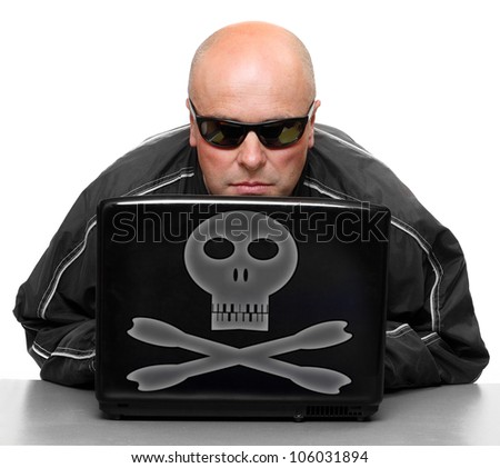 Dangerous hacker with laptop. - stock photo