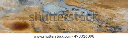 Dangerous hot steaming mud at Krafla, Iceland, where the Earth's crust is very thin and the air is filled with sulphurous fumes.