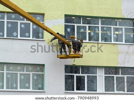 stock-photo-dangerous-job-painters-worki