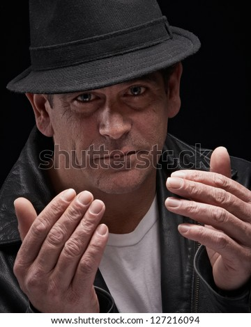 Dangerous looking man ready for confrontation - stock photo