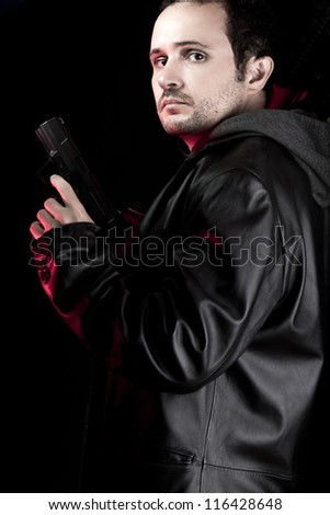 Dangerous man armed with a pistol, thief - stock photo