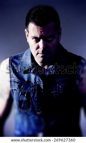 Dangerous man portrait.Angry face expression - stock photo