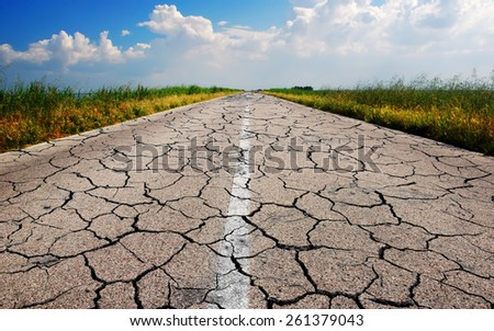 dangerous road with many cracks