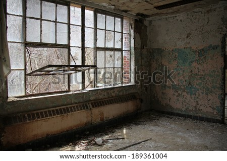 dangerous room and windows in an abandon mental hospital - stock photo