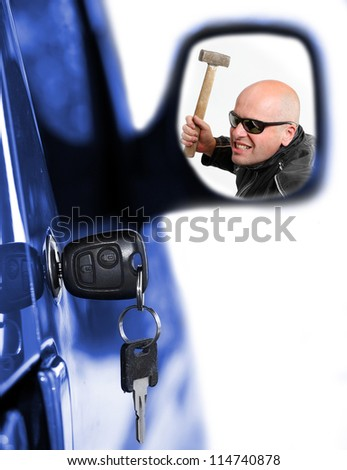 Dangerous thief in rear mirror and key at car doors. Car insurance concept. - stock photo